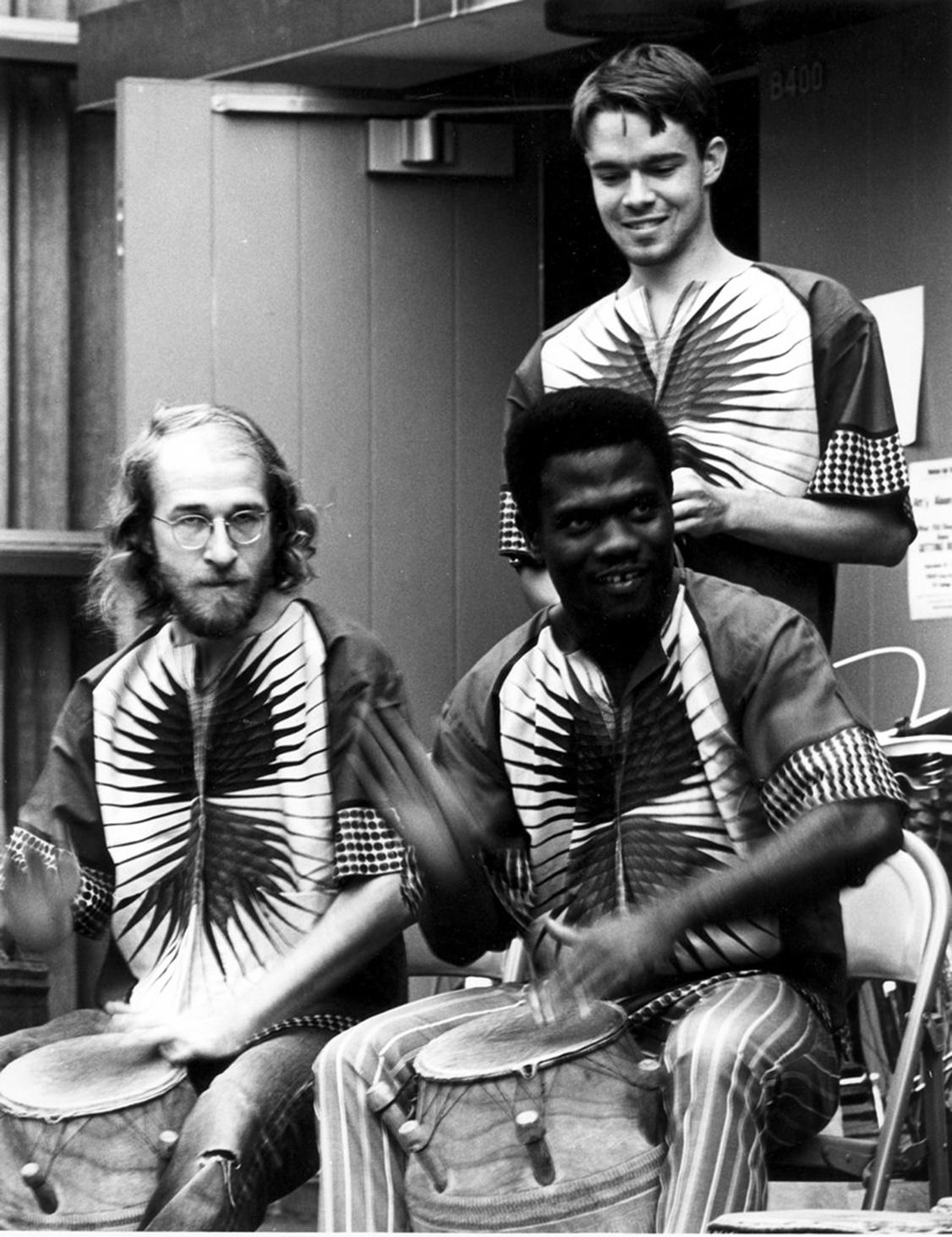 African drumming class at Wesleyan University; seated, left to right: Russell Hartenberger, Abraham Adzenyah; standing: Ben Baldwin. Photo: Bill Van Saun.
